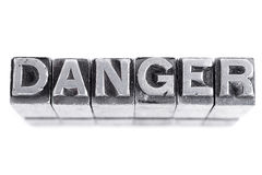 Danger sign, antique metal letter type Royalty Free Stock Images