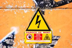 Danger sign of death by electricity and prohibition of entry stock photos