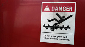 Danger Sign. Danger: Do not enter grain tank when machine is running Royalty Free Stock Photos