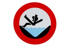 Danger Sign drowning. The sign warns of a dangerous, straightened brook. You can fall and drown Stock Photos