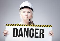 Danger sign held by worker Stock Image