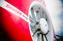 Danger Sign on Helicopter's Tail. Danger sign pointing towards the rotor at a helicopter's tail Royalty Free Stock Photos