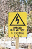 Danger sign for high vehicles. Danger sign restricting vehicles entering  to  less than a height of 7 metres because of high voltage electricity power lines Stock Photography