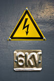 Danger sign high voltage. Warning with yellow electricity and six kilowatt sign Royalty Free Stock Images