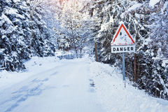 Danger sign on icy road Stock Image