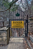 Danger sign and iron gate blocking nature trail Stock Photo