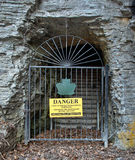 Danger sign and iron gate blocking nature trail Royalty Free Stock Photos