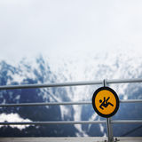 Danger sign at the mountains Stock Photo