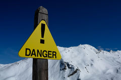 Danger sign in mountains Stock Photo