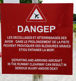 Danger sign next to runway at Gustaf III Airport at St Barts , French West Indies. Danger sign next to runway at St Barts Gustaf III Airport, French West Indies stock image