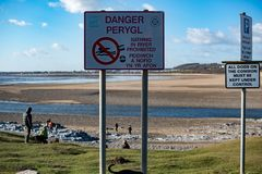 Danger sign, Ogmore estuary. Ogmore by sea, the estuary near low tide including the public information signs Stock Image