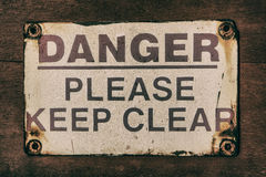 Danger Sign. Old faded danger warning sign Stock Photo