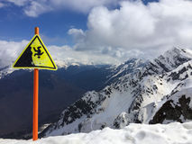 Danger sign at the peak of mountain at Sochi skiing resort in Ru Stock Photos