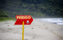 Danger Sign Pointing to a Beach in Brazil Stock Photography