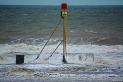 Danger sign and rough sea Royalty Free Stock Photo