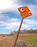 Danger sign shot up. Danger sign along a country road that has been shot repeatedly stock photo
