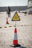 Danger sign with skull and crossbones, firefighters on background Stock Photography