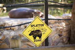 Danger sign. Splatter zone sign showing consequences of getting too close to a hippo at a florida zoo stock photography