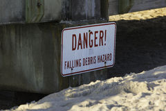 Danger sign at St Augustine Beach pier, Florida Royalty Free Stock Image