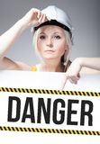 Danger sign on template board, worker woman Royalty Free Stock Photography