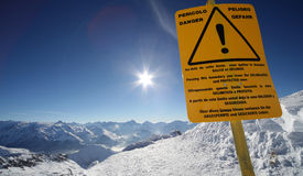 Danger sign, top french resort. Image of snowy mountains with danger sign in Alpe d'Huez, France Stock Photos