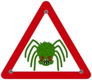 Danger sign with very scary green spider stock photo