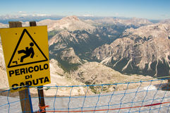Danger sign. Sign warning against falling from the mountain Stock Photography