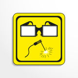 Danger sign. Welding works. Vector icon. Royalty Free Stock Images