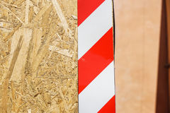 Danger Sign on Wooden Fence . Danger Sign on Wooden Fence wall at construction site stock photos