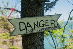 Danger sign. In the woods on a tree Royalty Free Stock Photos