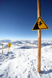 Danger sign, at your own risk. Image of warning sign in Alpe d'Huez Royalty Free Stock Photography
