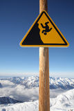 Danger sign, at your own risk. Image of warning sign in Alpe d'Huez Royalty Free Stock Image