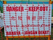 Danger signage. Danger keep out signage in red wording with white background Royalty Free Stock Photography