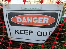Danger signage. Danger Keep out signage in white background Royalty Free Stock Photos