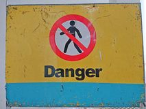 Danger signage. Danger Keep out signage in yellow background Royalty Free Stock Photography