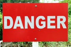 Danger signage. In red background with white wording Royalty Free Stock Images