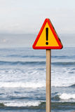 Danger signal. Indefinite danger signal with the sea to the bottom Stock Photography