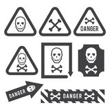 Danger. Signs indicating the danger, skull and bones, watch out royalty free illustration