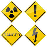 Danger signs set. Radiation, high voltage, attention Stock Photos