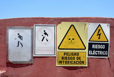 Danger signs in Spanish. A collection of warning and danger signs in Spanish Royalty Free Stock Photography