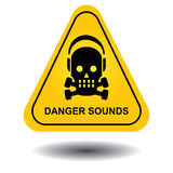 """Danger sounds. An illustration of a warning sign with a skull wearing earmuffs and the text """"danger sounds Stock Photos"""
