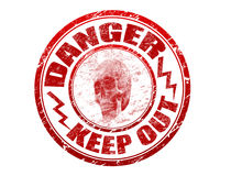 Danger stamp. Abstract red rubber office stamp with skull, electricity symbols and the text danger keep out written inside the stamp Stock Photography