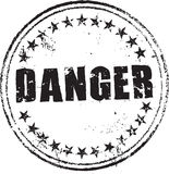 Danger stamp. Abstract grunge rubber stamp with the text danger stock illustration