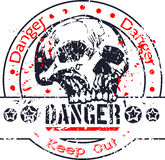 Danger stamp with skull Stock Image