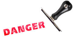 Danger stamp text with stamper. Rubber stamp illustration showing `DANGER` text Royalty Free Stock Photos