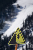 Danger steep cliff mountain sign Stock Photo