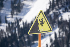 Danger steep cliff mountain sign. Ski resort Stock Image