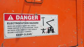 Danger sticker sign and symbol on electrocution hazard machine. Macro photo focus select at Exclamation mark and Danger word royalty free stock image