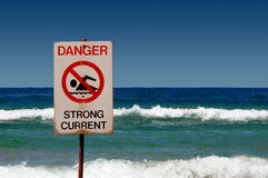 Danger Strong Current. No swimming sign at the beach Stock Images