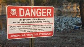 Danger swim at own risk stock photos